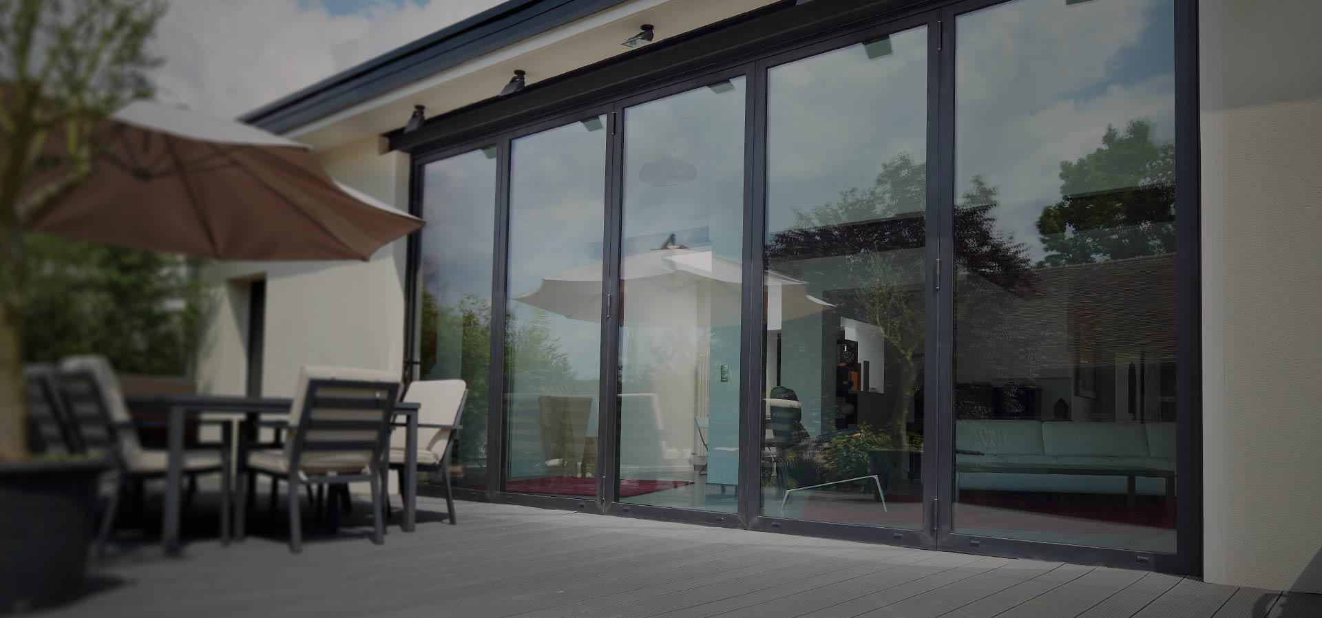 Wide span of Raum aluminium bifold doors over looking the patio area