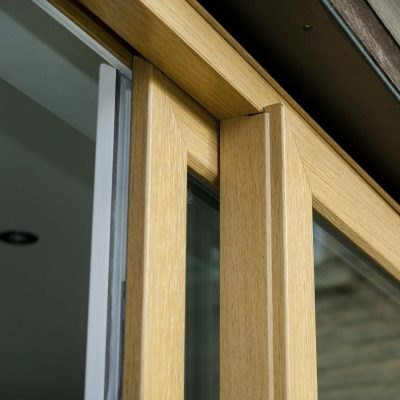 Sliding patio door close up with golden oak finish