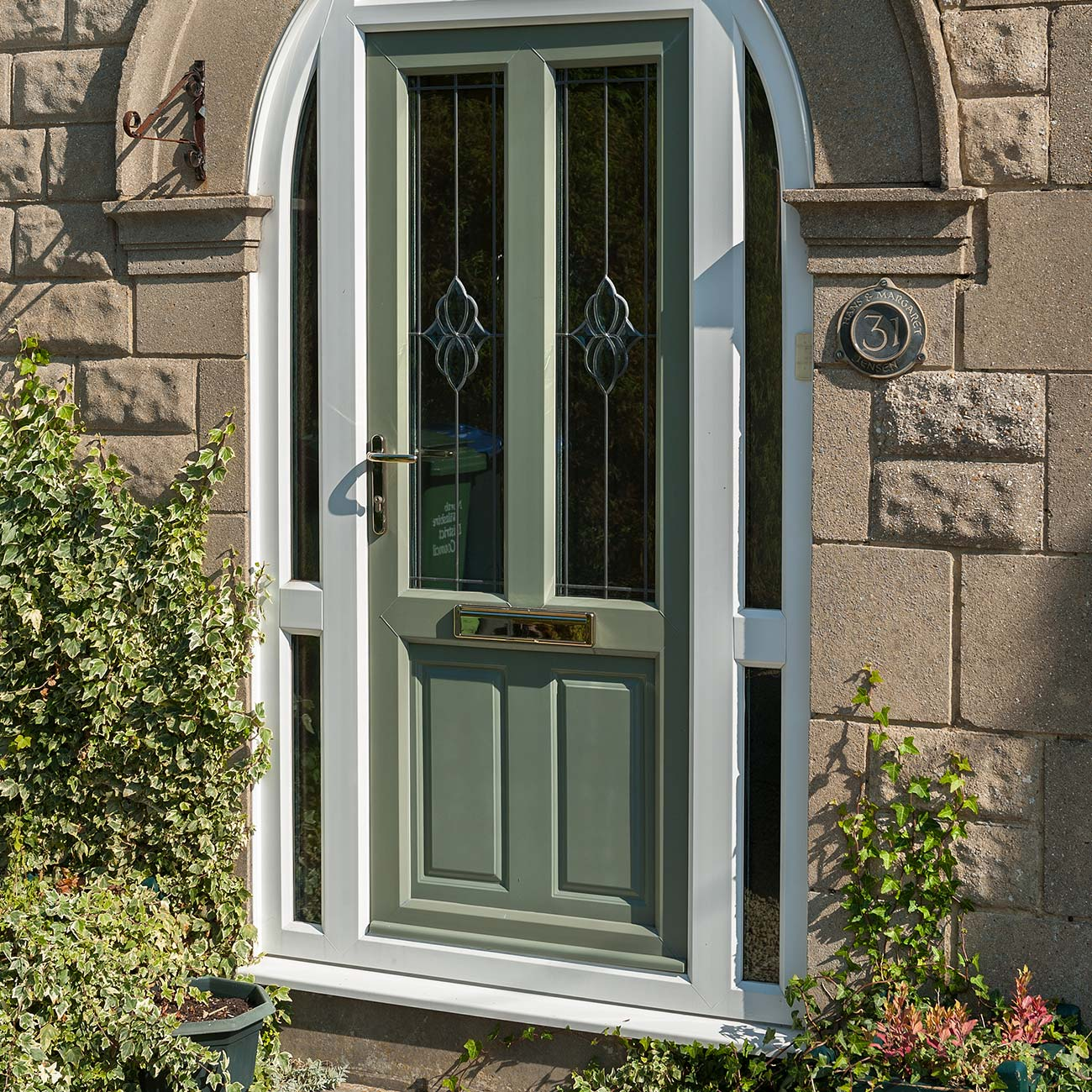 Chartwell green upvc entrance door with gold furniture