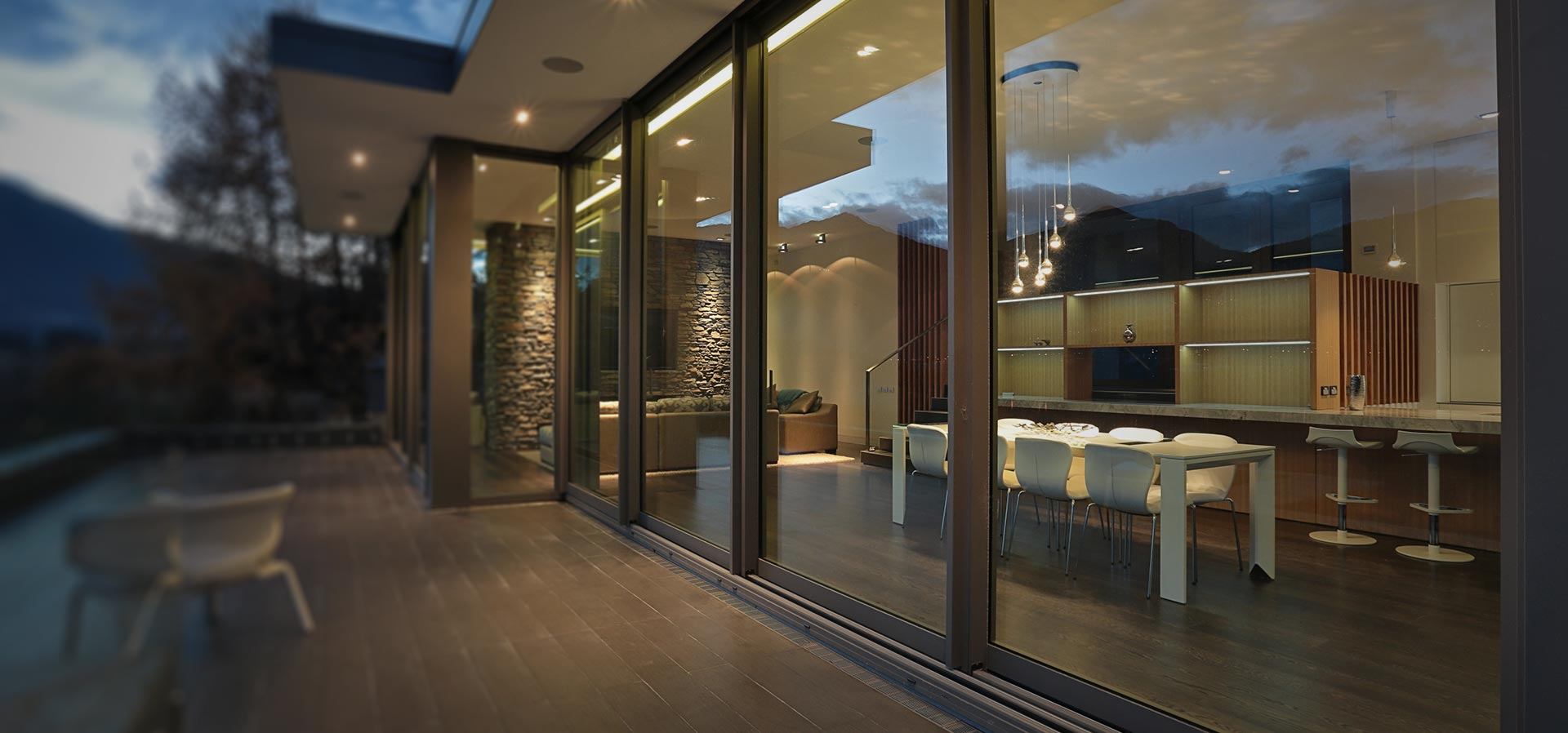 Large span of sliding aluminium patio doors with large glass area which provide a modern contemporary view