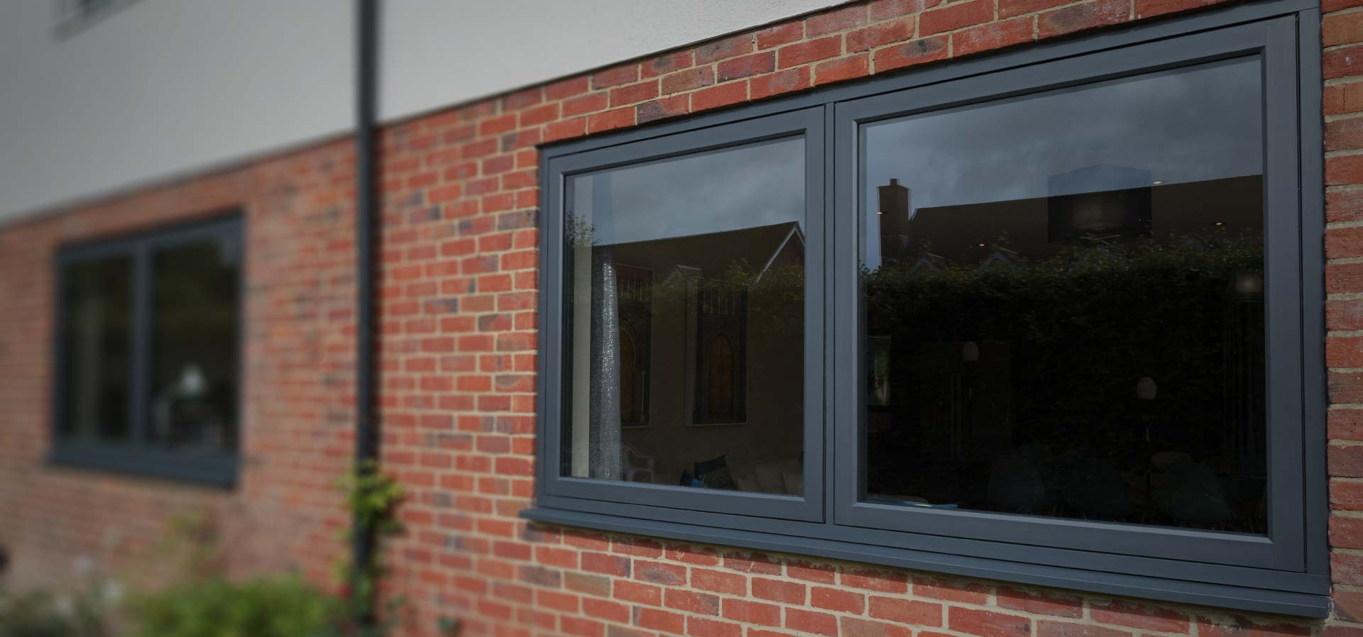 An external view of some Residence 7 upvc windows in anthracite grey finish