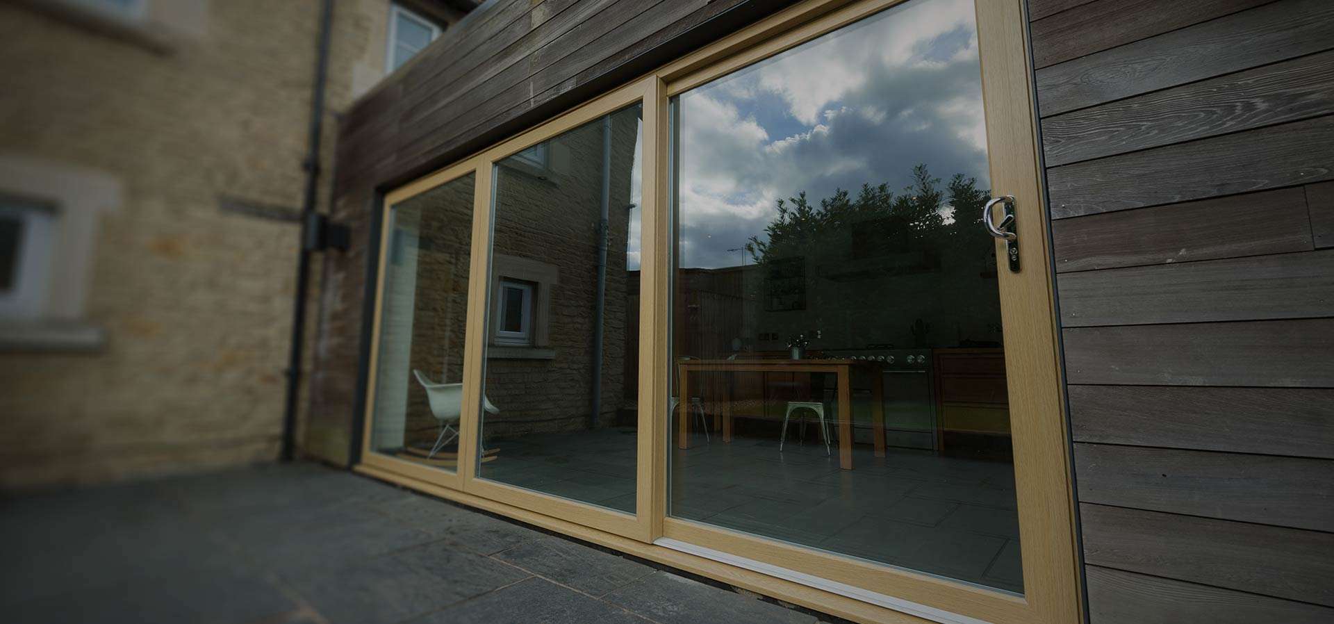 A uPVC sliding patio door in golden oak manufactured using Deceuninck's Slider24 patio door system