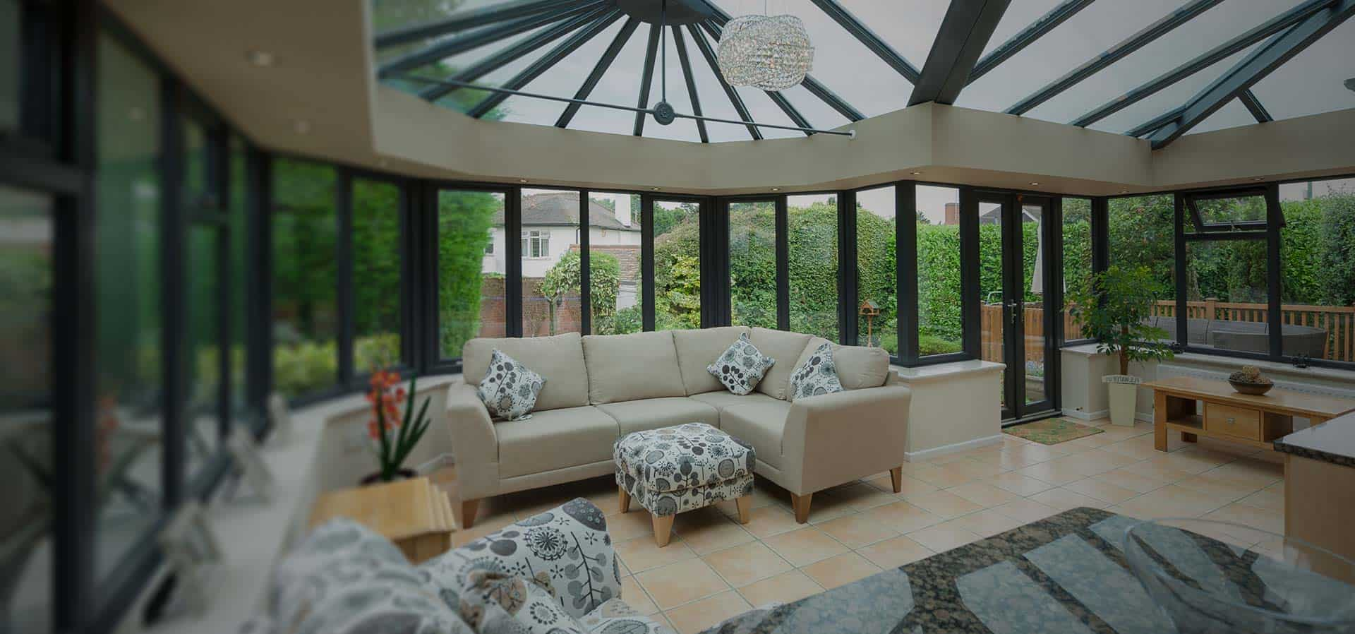 Conservatory with wall to wall windows and doors with glass roof